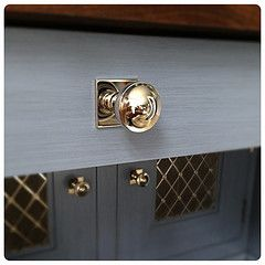 Wilmette Cyma Polished Cabinet Knob With Square Back Plate