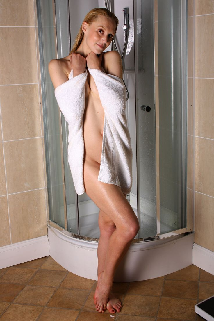 Naked pics of this hot blonde with nice tits removing her towel after shower