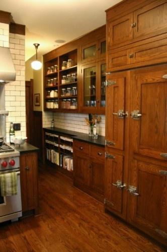 old style ice box latches, shallow honed countertop with subway tile under old apothecary/drugstore cabinets AND the schoolhouse lights we're using throughout the house!