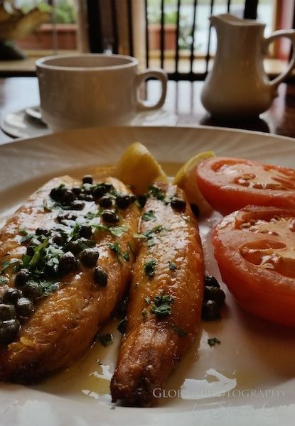 Kippers with lemon butter and capers for breakfast in Ireland. A traditional fish breakfast for this seafaring island. I found these delicious ones at Moorings Restaurant and Guesthouse in Portmagee Ireland. A kipper is a whole herring that has been sl