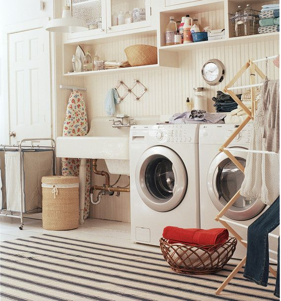 laundry room with charm and plenty of storage spots. photo: John Gruen