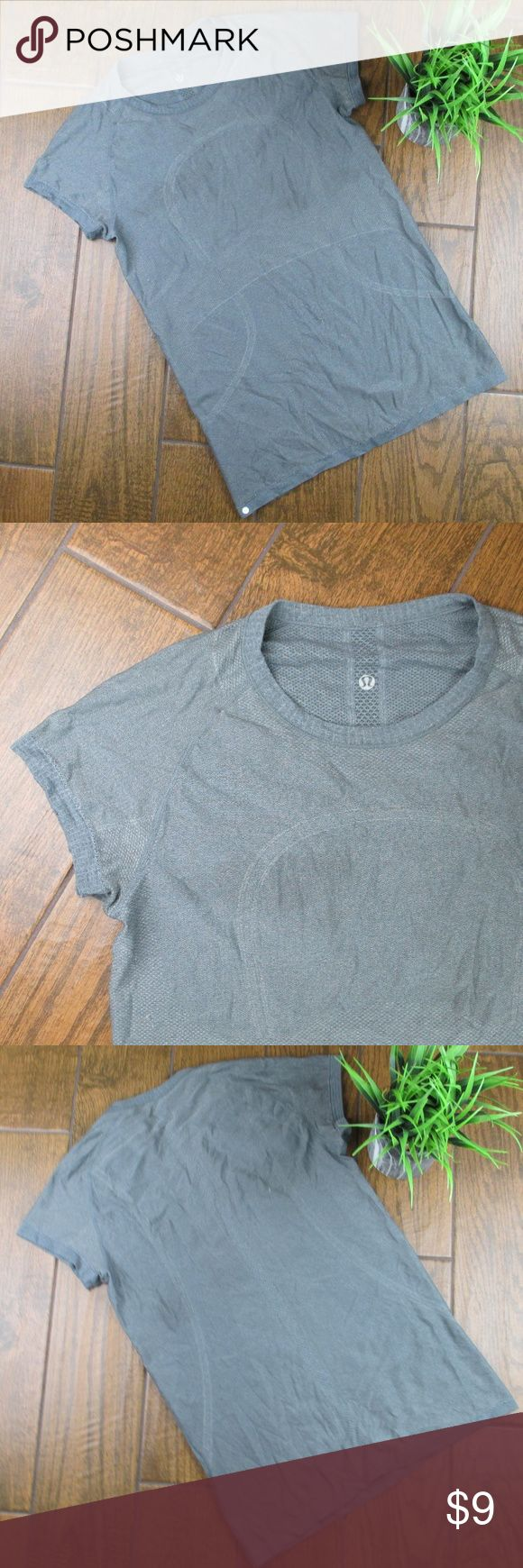 10 Lululemon Work Out Top Gray PRICE IS FIRM Lululemon athletic shirt Gray Size 10 PRICE IS FIRM The price is $9 because there is a flaw, there is a couple of small pulls on the shirt Other than that, there is no damage Bust from pit to pit is 20 inches Length is 32 inches Super stretchy  Add to a bundle for an automatic discount  Colors may very due to lighting, seller does its best to portray the right color. Please inspect all photos.  #J075 lululemon athletica Tops Tees - Short Sleeve