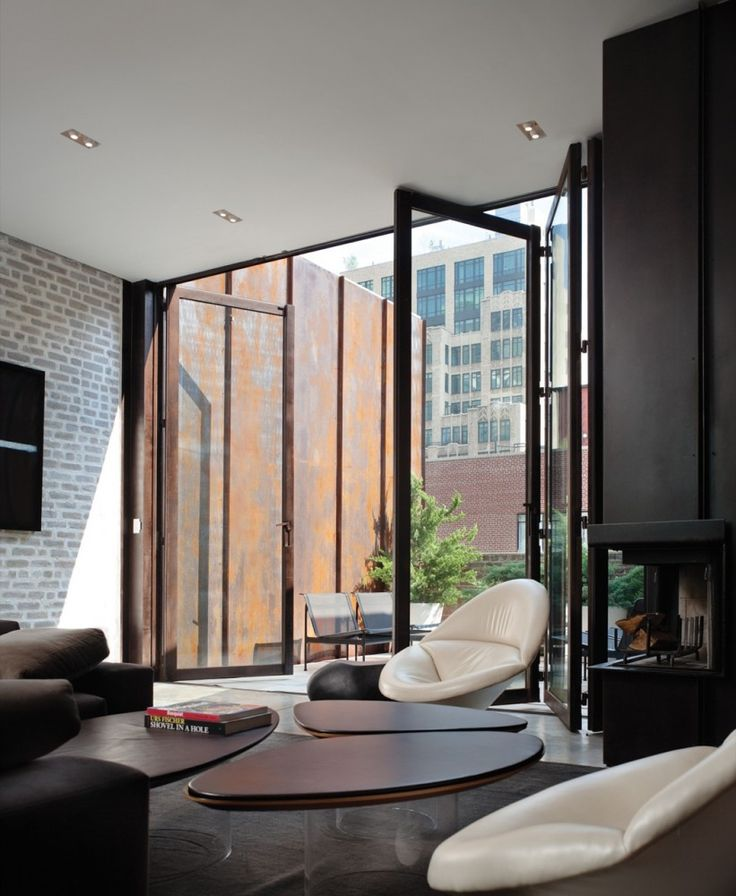 Folding windows create indoor/outdoor space. Inverted Warehouse -Townhouse / Dean-Wolf Architects