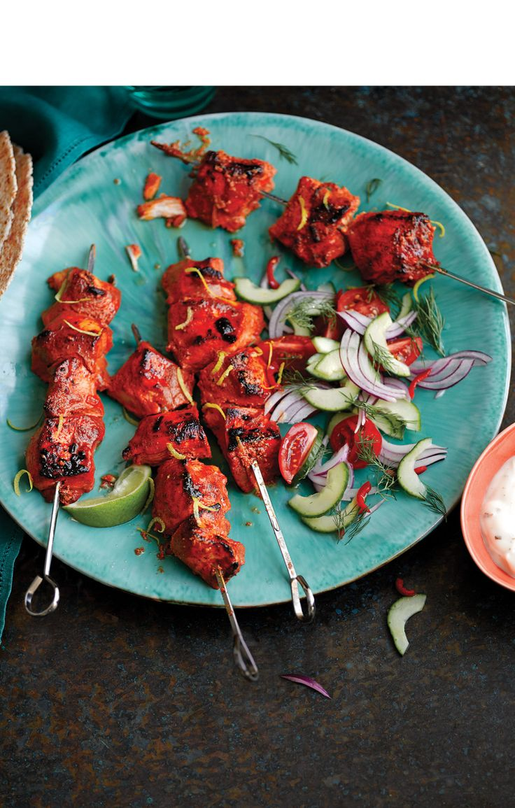 Chicken tikka skewers with red onion and cucumber salad