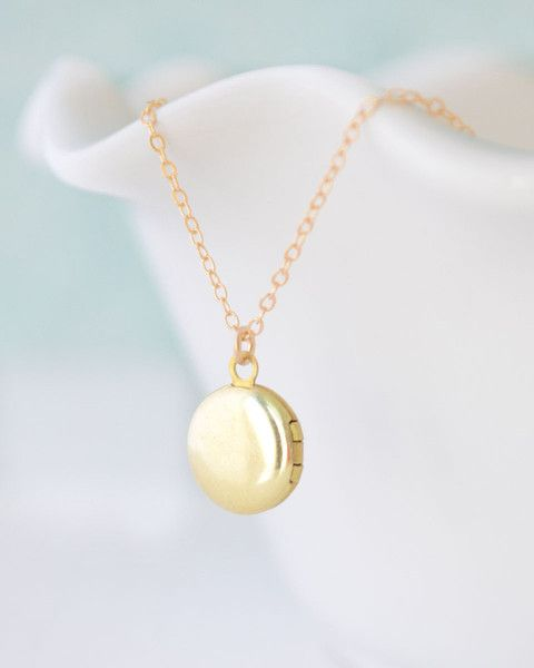 Small Locket Necklace - this adorable brass round locket charm is just big enough to hold a special memory. Sits on a gold chain. By Olive Yew.
