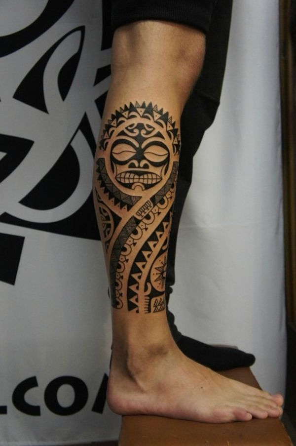 Black Polynesian Sun Tattoo on Right Leg