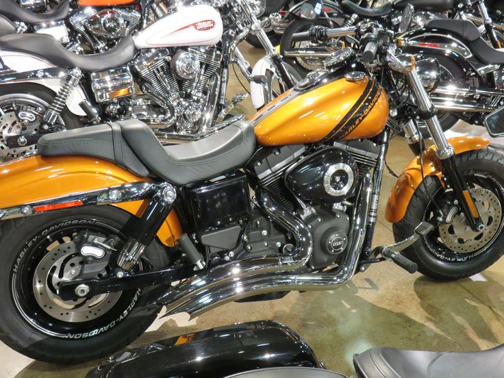Clare's Harley-Davidson Motorcycles -  2014 Harley-Davidson Dyna® Fat Bob® Amber Whiskey. A.B.S brakes, Factory security, V&H Big radius exhaust. 103 cu in, 6 speed, fuel injected.
