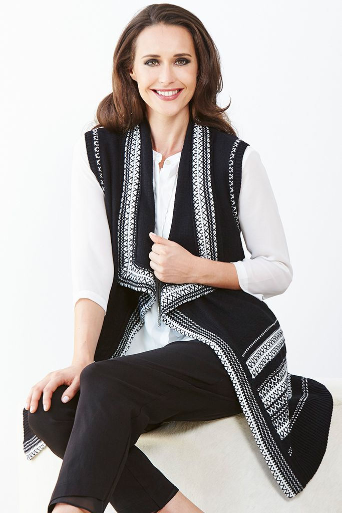 LONGLINE SLEEVLESS CARDIGAN This easy-layer knit from Liz Jordan is a versatile hero piece for the cooler weather. Featuring a classic black & white knit design, this sleeveless style has a long line construction, making it perfect for layering over all your long sleeve tops & pants.