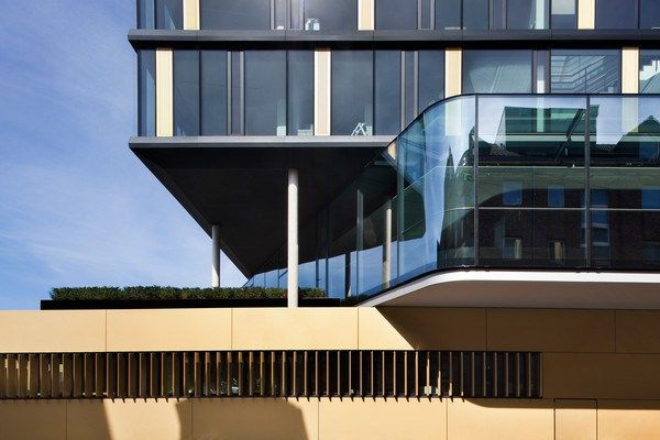 The office facade - a black anodized aluminum element construction in a structural glazing optic – each element 1.35 - 2.70 meters, analogue to the modular grid