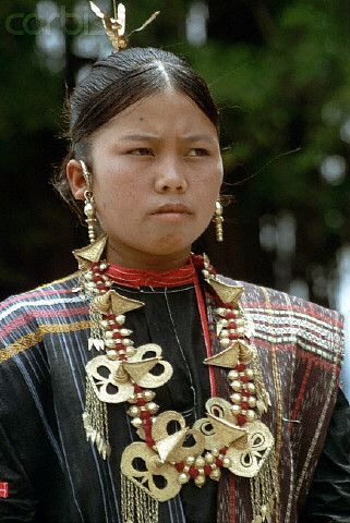 Indonesia | A Toba Batak girl in traditional dress in Sumatra | © Charles & Josette Lenars