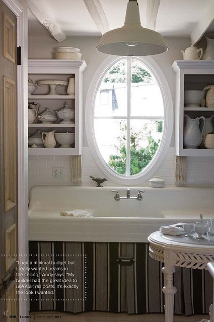 Pretty vintage kitchen with oval window & large farmhouse sink
