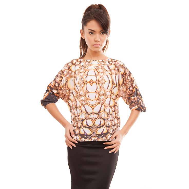 http://mrgugu.com/collections/gugu-gold/products/gold-black-blouse