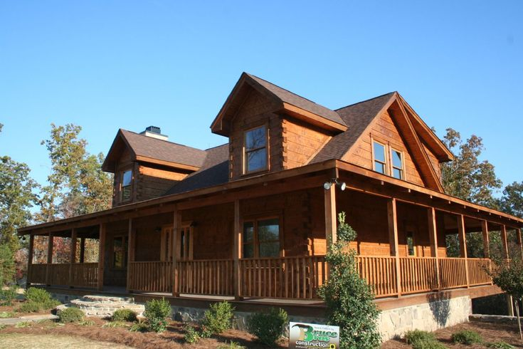 Design log homes with wrap around porches featured for Cabin wrap around porch