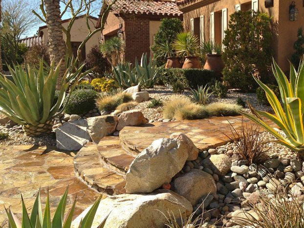 Good Stone Paving, Boulders And Smooth Rocks, Native Grasses, Agave Americana  And Other Succulents Mix Old World And New World Styles To A Front Yard.
