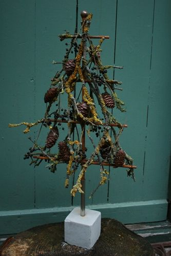 Juletræ i jern bundet med lavgrene