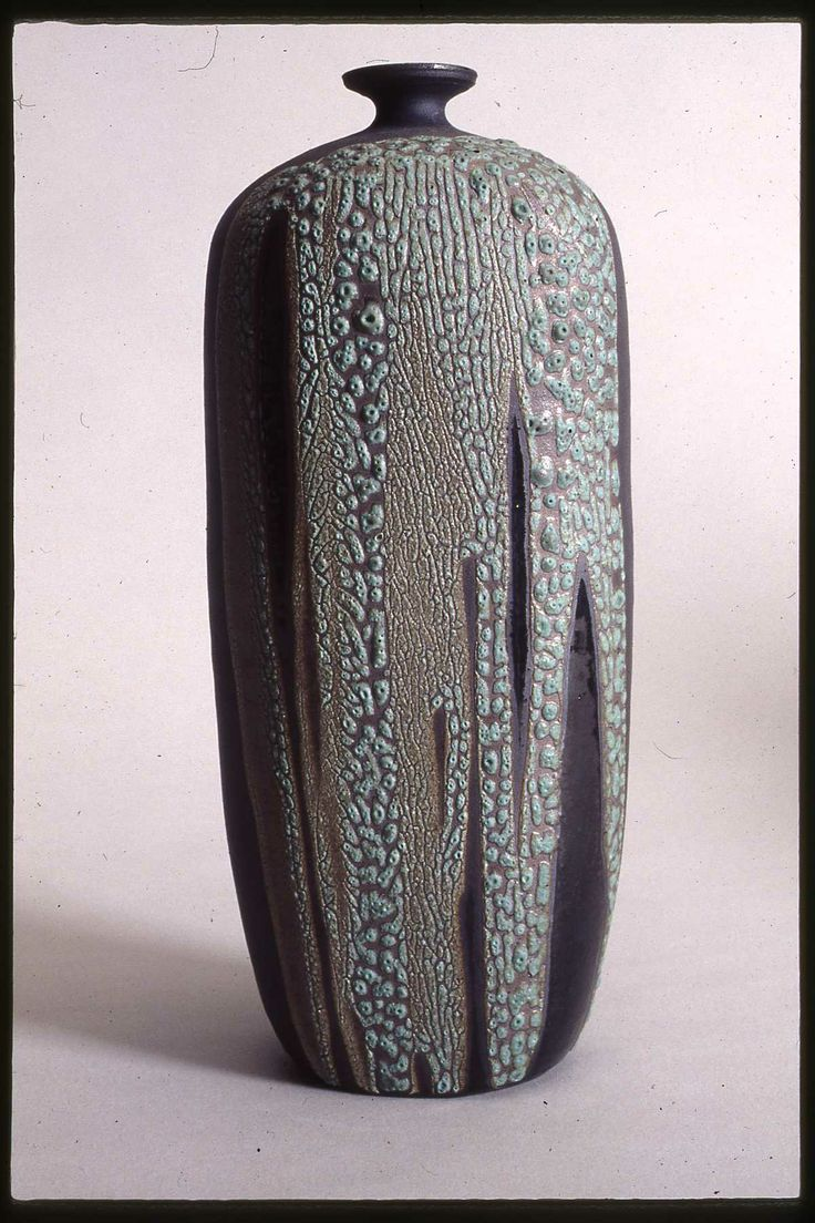 Christy Johnson - Cassius Basaltic clay. Fires black; cone 5; oxidized; copper oxide, green crater glaze; clear glaze.
