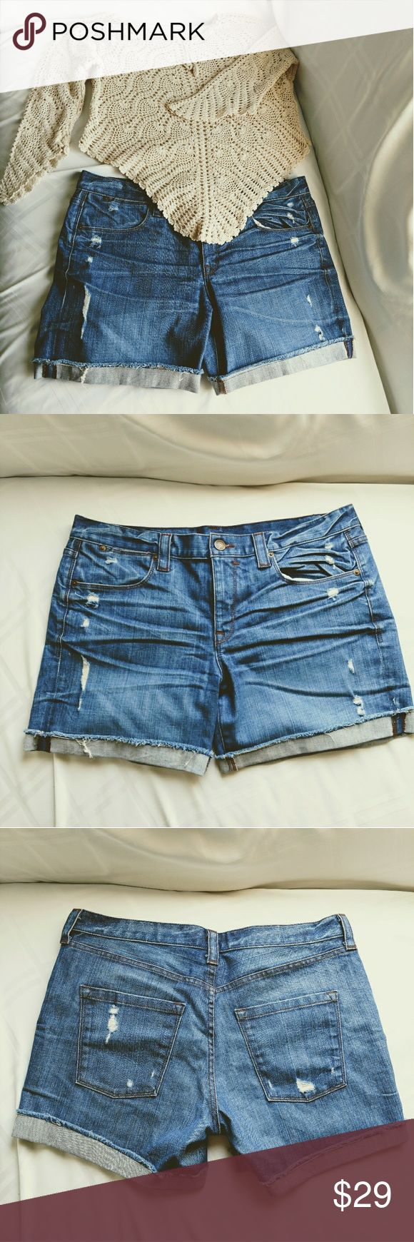 J. Crew Distressed Blue Denim Shorts Size 32 Totally adorable distressed Indigo colored denim shorts by J. Crew. Size 32. Inseam (unfolded) 7 Inches. With natural fold is approximately 5 1/2 inches. Excellent condition! J. Crew Shorts Jean Shorts
