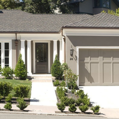 White Trim And Grey Stucco Garage Door Painted The Body Color Trimmed Out In White