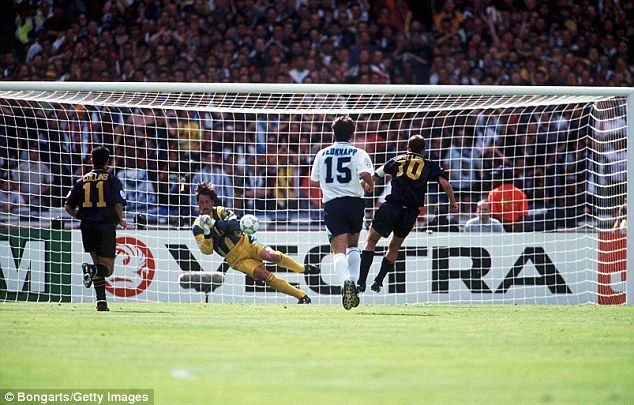 Scotland's Gary McAllister strikes his penalty towards goal but David Seaman saves it