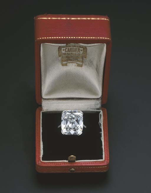 AN EXCEPTIONAL DIAMOND SINGLE-STONE RING, BY CARTIER  The old-cut rectangular-shaped diamond weighing 14.16 carats to the five-stone single-cut diamond shoulders and plain hoop, with French assay mark for platinum, in original Cartier red leather fitted case Signed Cartier