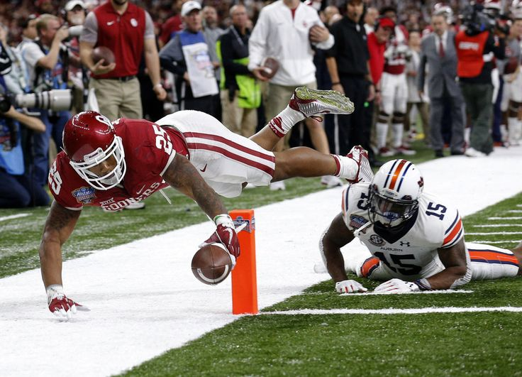 Oklahoma's Joe Mixon (25) scores a touchdown over Auburn's Joshua Holsey (15) in the third quarter during the Allstate Sugar Bowl between University of Oklahoma Sooners (OU) and Auburn University Tigers at the Mercedes-Benz Superdome in New Orleans, Monday, Jan. 2, 2017. Photo by Sarah Phipps, The Oklahoman
