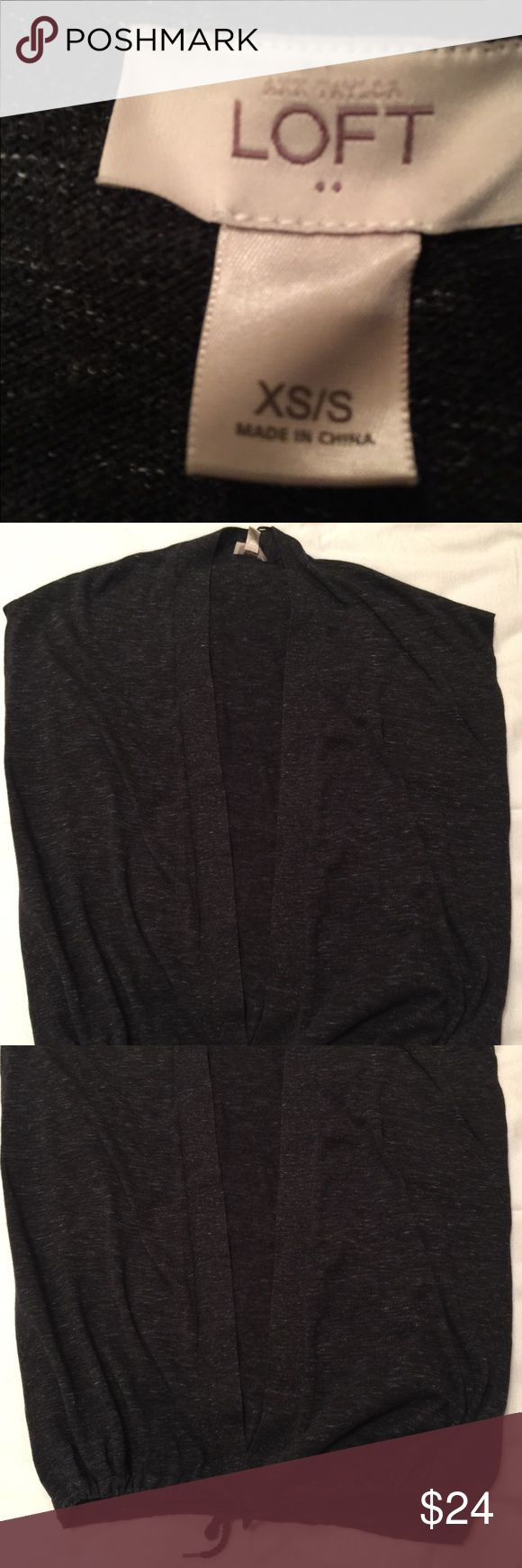 Ann Taylor Loft Sleeveless top Anne Taylor Loft Sleeveless Wrap Top with drawstring tie at bottom.  Fabric is lightweight super soft sweater material in a heathered Black.  EUC. LOFT Sweaters Shrugs & Ponchos