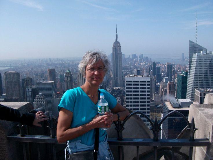 New York på toppen  af Rockefeller center med Empire state building i baggrunden New york