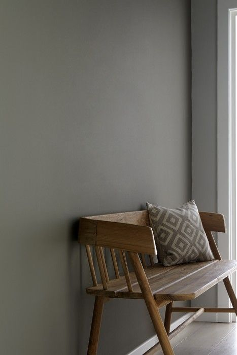 grey hall with wooden bench. Wall painted in grey moss from Little Greene