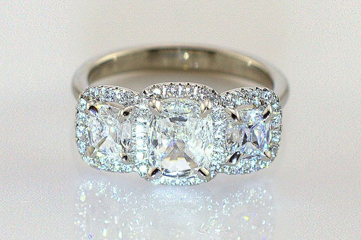 Henri Daussi Three Stone Diamond Engagement Ring in Platinum