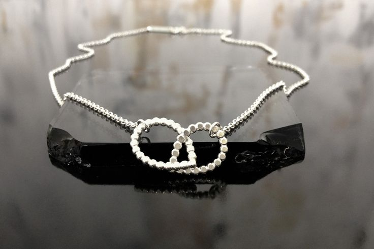 Ladybug necklace. Gina Bulgamin.