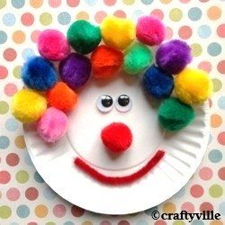 colorful pompoms to make a clown from a paper plate