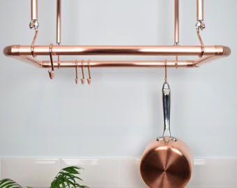 Proper Copper Pan Rail  Here you have a practical hand crafted POT AND PAN RACK/RAIL.  Will grace any kitchen, and is exclusively designed by Proper copper design company. Perfect for enhancing a modern, industrial look. These rails Can be fitted as a single rail, double or triple rail, for a fantastic storage solution for all your pots, pans and utensils!  FINISHES: You can choose from our 2 wonderful finishes: *Natural Copper or *Satin Lacquered (see below for full details)  *NATURAL C...
