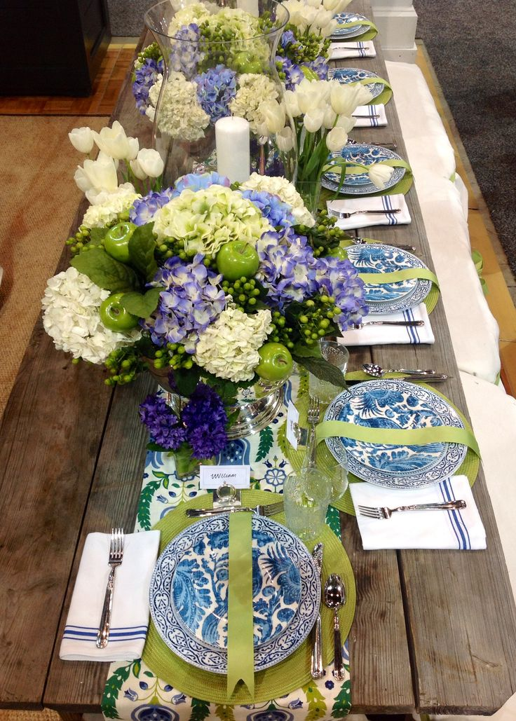 Blue and white tablescape with chartreuse, hydrangeas and green apples
