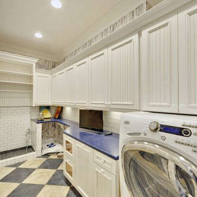 Great laundry room layout with dog bed and bathing station