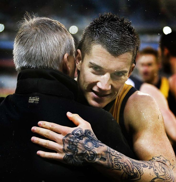 Dusty Hugs Gary March after the Tiges win against the Hawks- Please pleas lease stay Dusty -Tiger for life