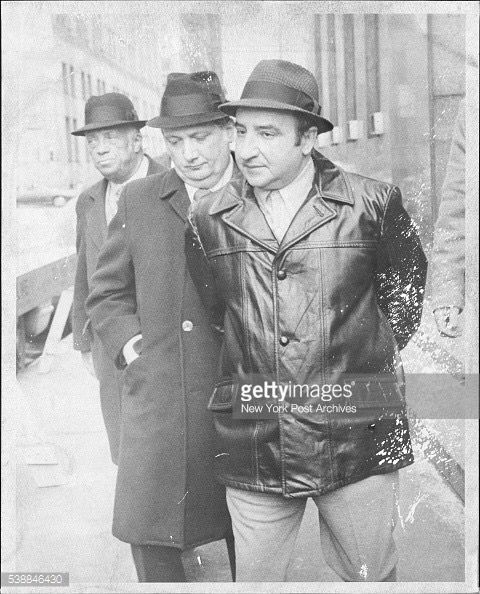 Rare picture of Colombo consigliere and acting boss Joseph Yacovelli being escortes from the District Attorney's office for booking today. February 02, 1974.