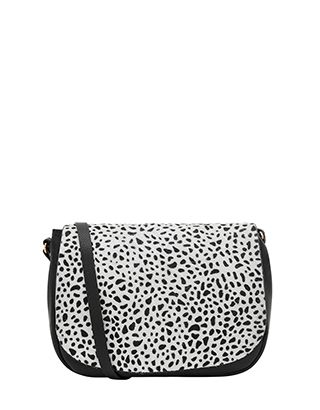 Make way for monochrome with our Zoe saddle bag. This so-chic style features a top flap of printed pony hair and is crafted from leather for an endlessly lux...
