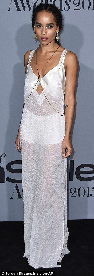 Stunning: California-born Zoe displayed her slender figure in a sheer white Calvin Klein g...