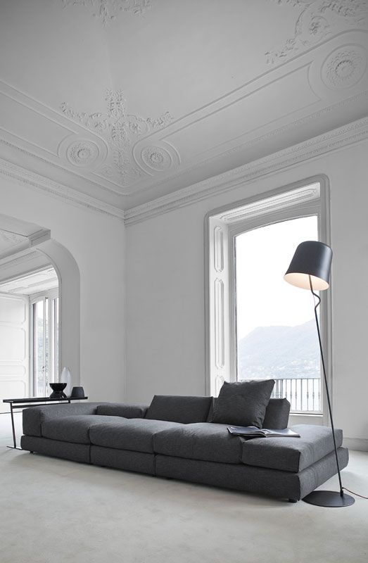 Grey Sofa. Couch. Living Space. Minimalist. Modern. Design. Decor.