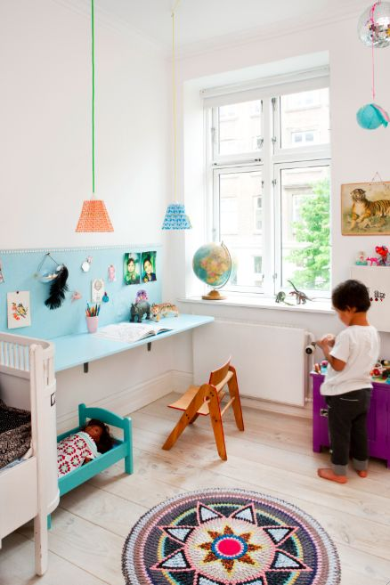 Turquoise desk. Fold down with shelf above for storage in children's room