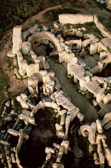 "Aerial view of Hagar Qim, Malta. It is a megalithic temple complex found on the Mediterranean island of Malta, dating from the Ġgantija phase (3600-3200 BC). The Megalithic Temples of Malta are amongst the most ancient religious sites on Earth, described by the World Heritage Sites committee as ""unique architectural masterpieces."