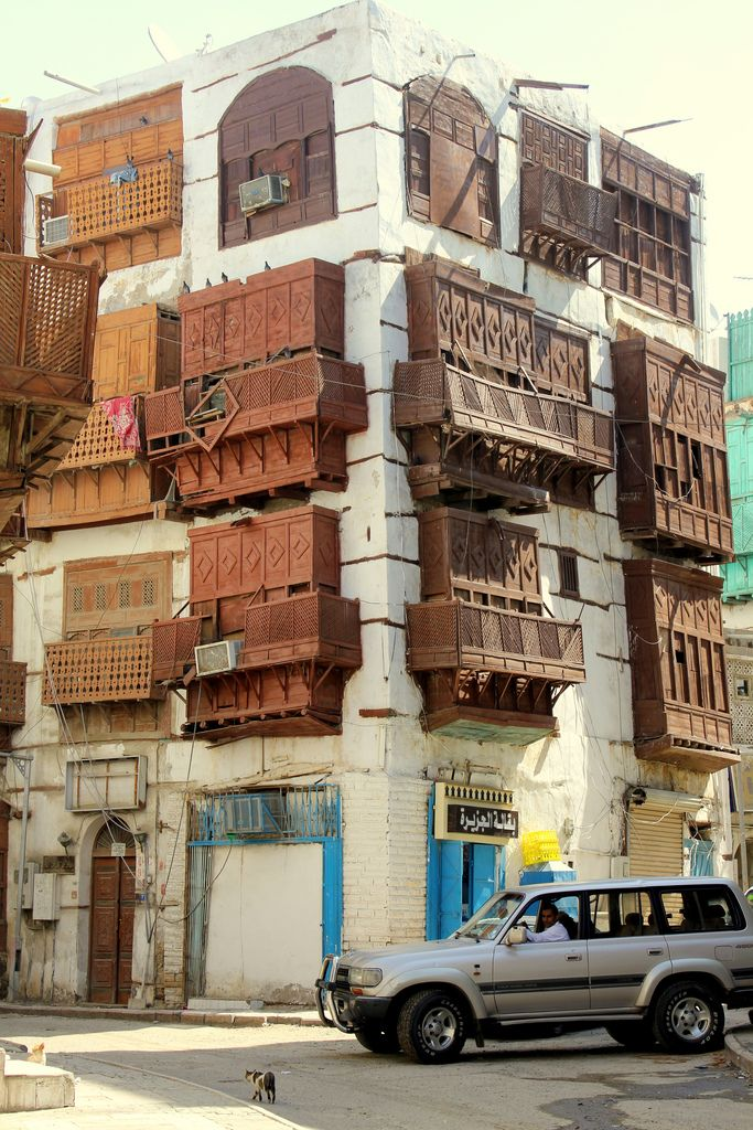 """ARABIAN  Mashrabiya (Shanasheel) windows in Jeddah, Saudi Arabia.  - """"The mashrabiya emerged from the practice of cooling pots of drinking water in an enclosed wooden shelf by the window. The latticework and the projected bay allowed cooling winds to pass into the interior while filtering out the hot afternoon sunlight."""" -Kalpana Gurung"""