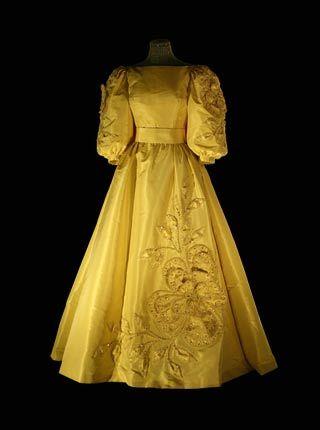 1985 - WORN BY QUEEN SILVIA OF SWEDEN TO NOBEL CEREMONY. GOLD EMBOSSED APPLIQUE OF FLOWERS. DESIGNED BY JORGEN BENDER