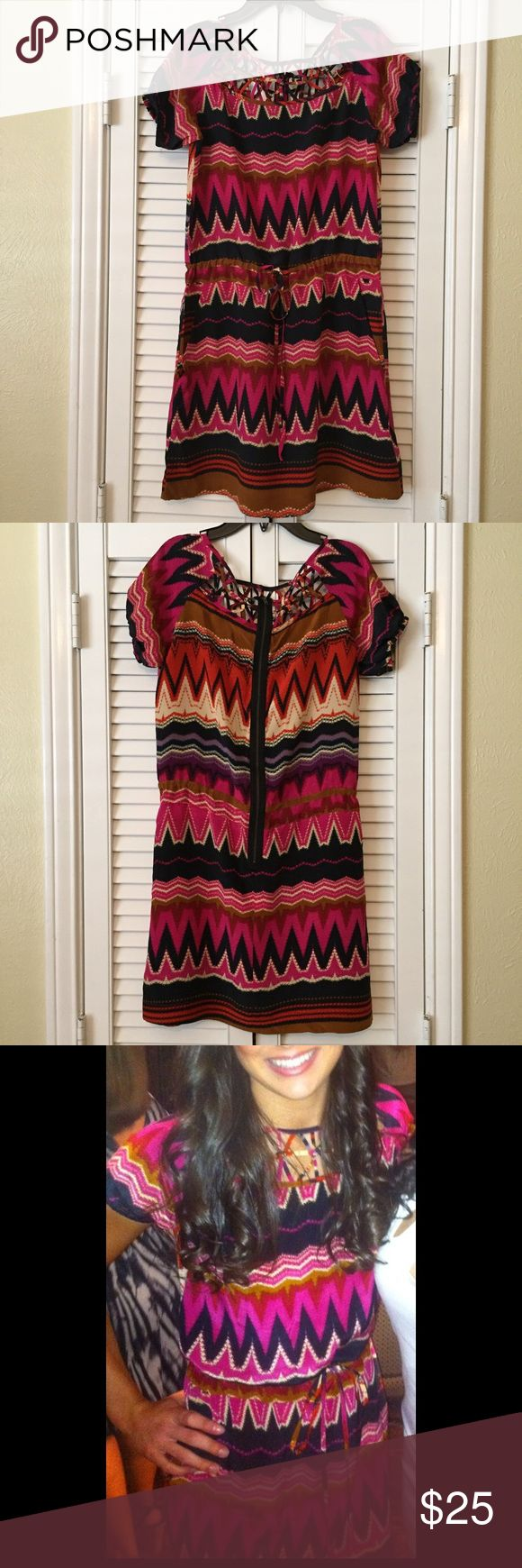 Gianni Bini tribal print dress. I have pockets!! Cute dress cut out around the top. Cinched around the waist. Exposed zipper in the back. Gianni Bini Dresses Midi