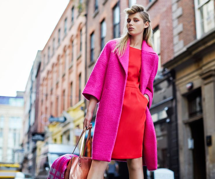 Wide-sleeved pink coat in textured fabric with red tailored dress by Savida