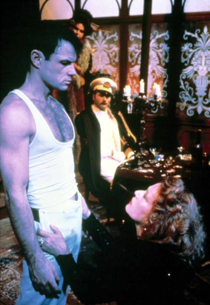 Brad Davis, Jeanne Moreau, and Franco Nero in Querelle (1982)