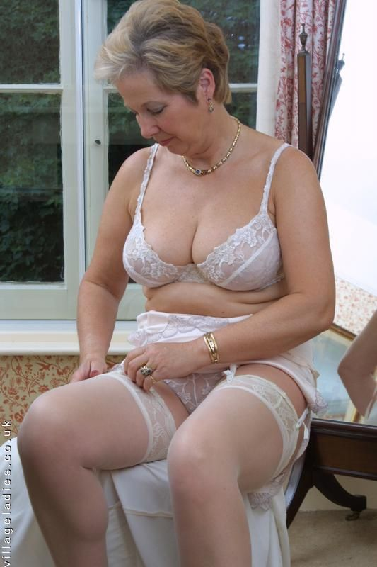 Nude matures in girdles