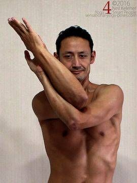 Eagle arm position shoulder stretch, forearms tipped to one side.  neil keleher, sensational yoga poses.