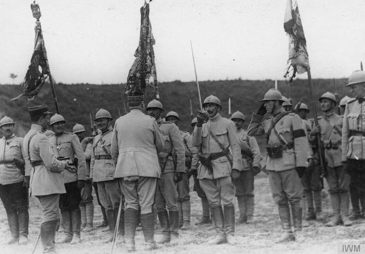 General Henri Mathias Berthelot awarding decorations to Romanian troops at the Front near Caiuti, 1917