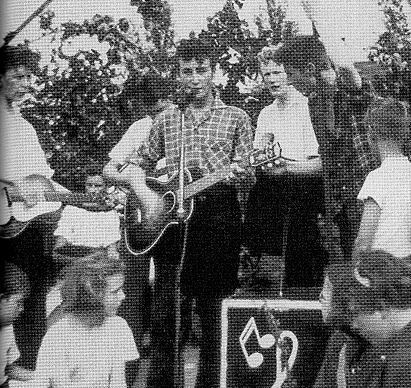 Taken the day John met Paul.  July 6th, 1957.  Liverpool, England.    The Quarrymen playing at St. Peter's Church garden fête.